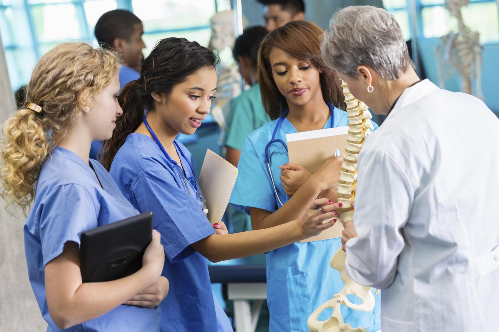 Medical School Professor Using Model To Teach Nursing Students The